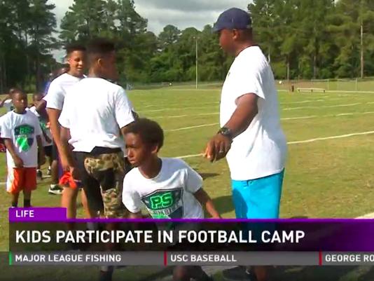 Kids Participate in Football Camp